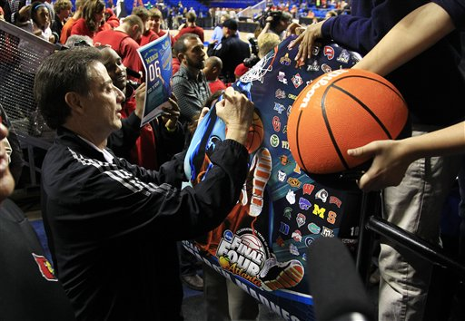 Rick Pitino signs autographs before practice at Rupp Arena on Wednesday. (AP)