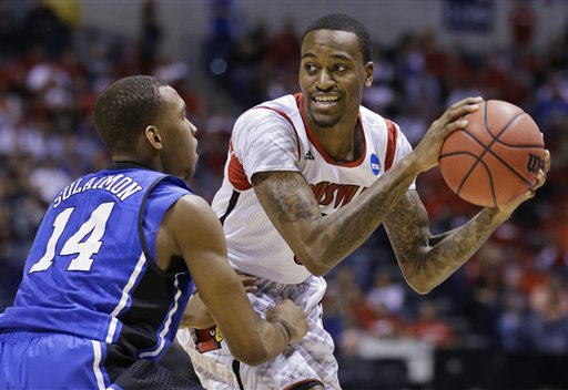 Kevin Ware looks to pass against Duke before the accident. (AP)