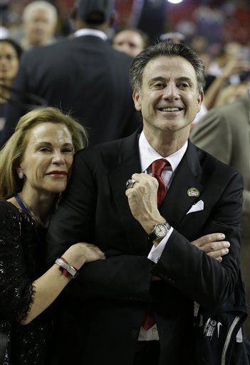 Louisville head coach Rick Pitino with his wife Joanne as the Cardinals celebrate. (AP)