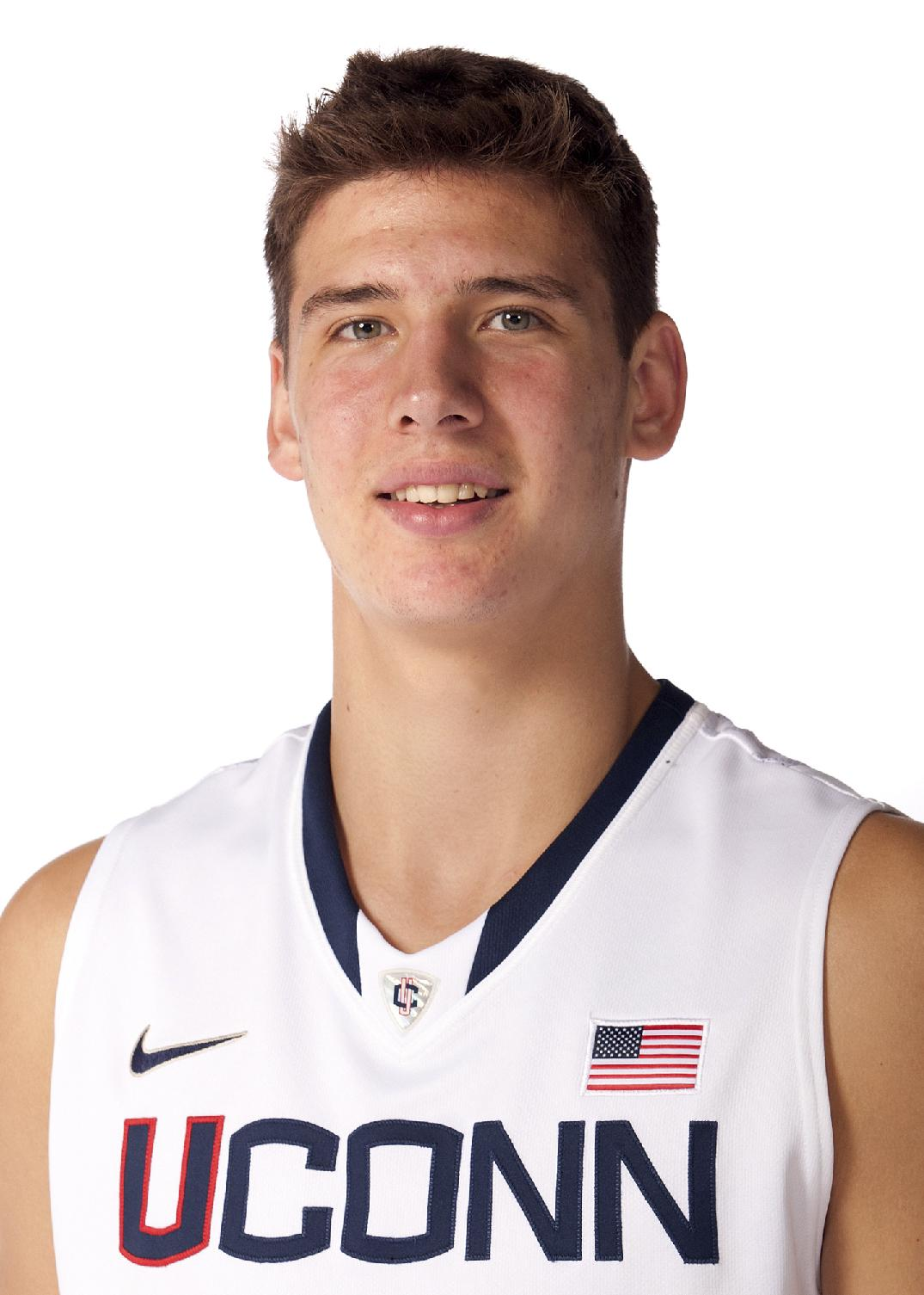 This Sept. 24, 2011 file photo provided by the University of Connecticut Athletic Department shows men's basketball player Tyler Olander. Olander pleaded guilty to driving without a license, Monday, Sept. 23, 2013 in Rockville Superior Court, in Vernon, Conn. He was suspended from the basketball team earlier this month after he was charged with operating under the influence of drugs or alcohol, but tests showed Olander was under the legal limit