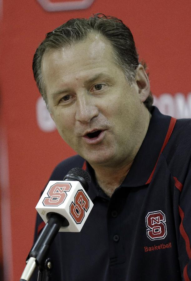North Carolina State coach Mark Gottfried responds to a question during the team's NCAA college basketball media day in Raleigh, N.C., Monday, Sept. 30, 2013