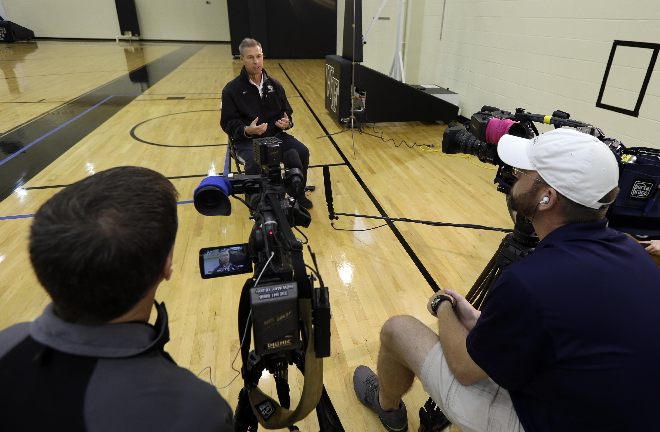 Wake Forest head coach Jeff Bzdelik is interviewed during NCAA college basketball media day in Winston-Salem, N.C., Tuesday, Oct. 8, 2013