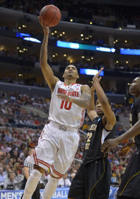 In this March 30, 2013 file photo, Ohio State forward LaQuinton Ross (10) goes up for a shot against Wichita State in the second half of a West Regional final in the NCAA college basketball tournament in Los Angeles. With the start of the 2013-14 season, Ross steps into the spot as the Buckeyes' designated point-producer for departed Deshaun Thomas, who averaged 19.8 points a game a year ago