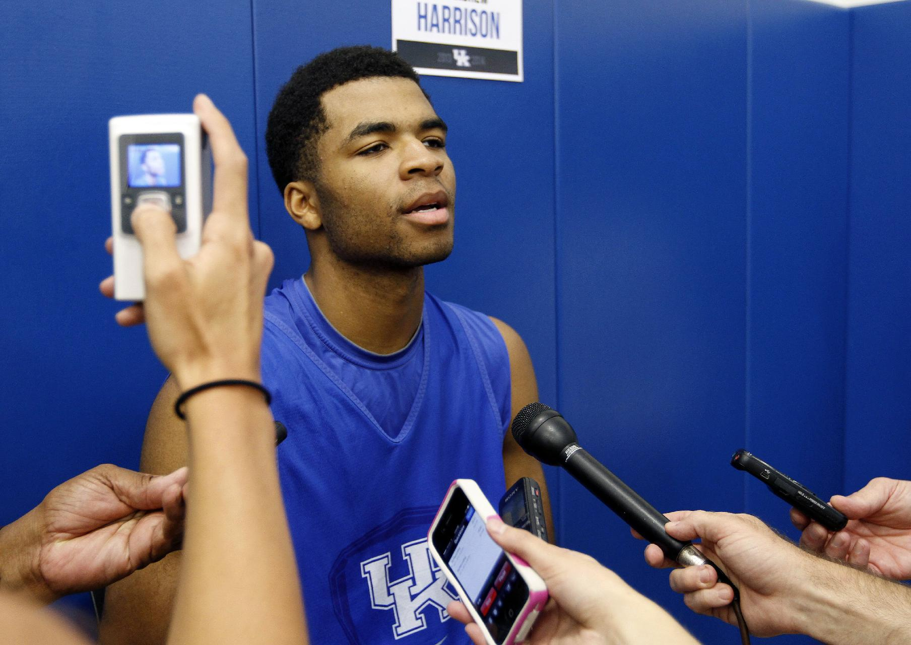 Andrew Harrison answers a question during Kentucky's media day. (AP)