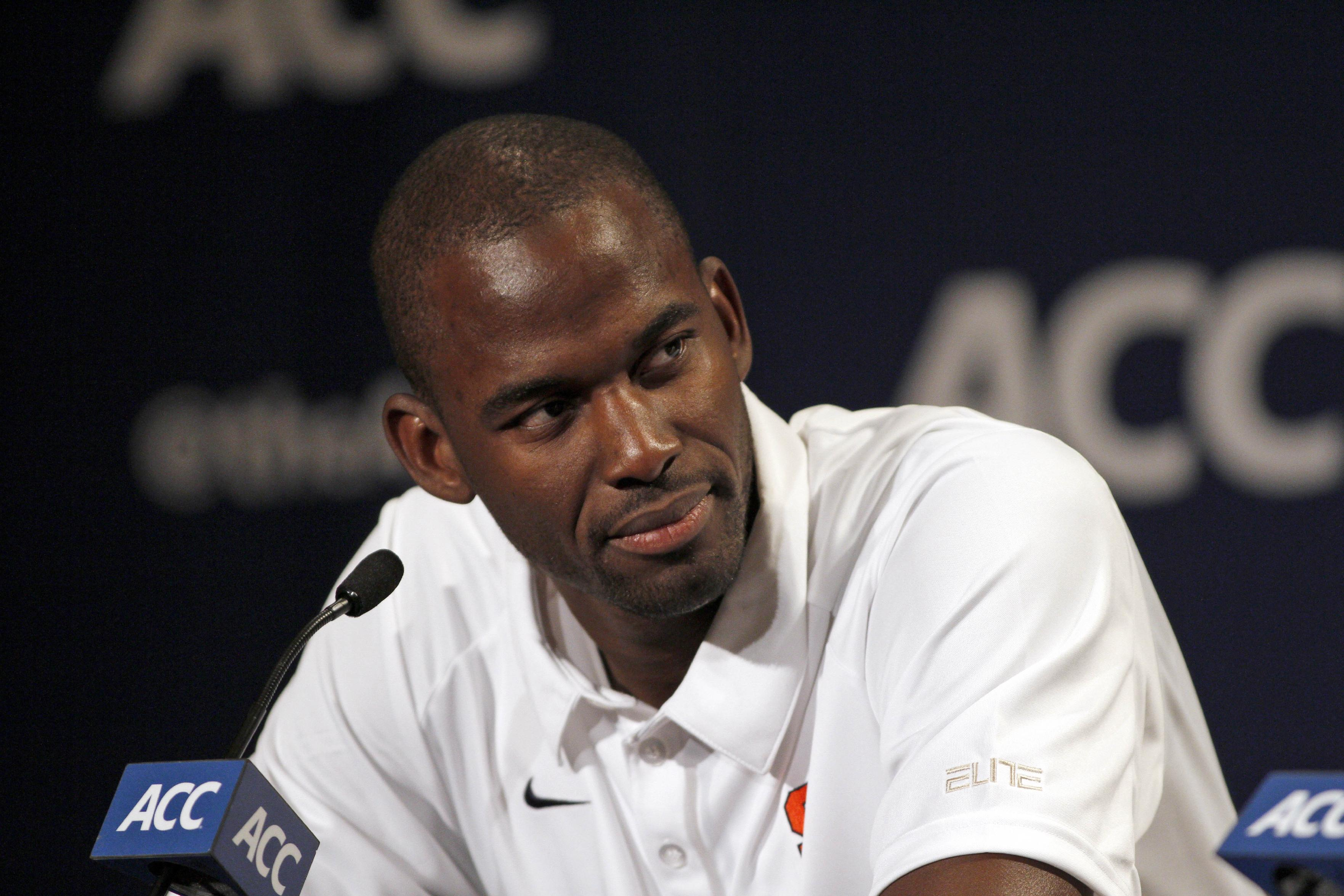 Syracuse basketball player Baye Moussa Keita answers questions at a press conference during the NCAA college basketball Atlantic Coast Conference media day in Charlotte, N.C., Wednesday, Oct, 16, 2013