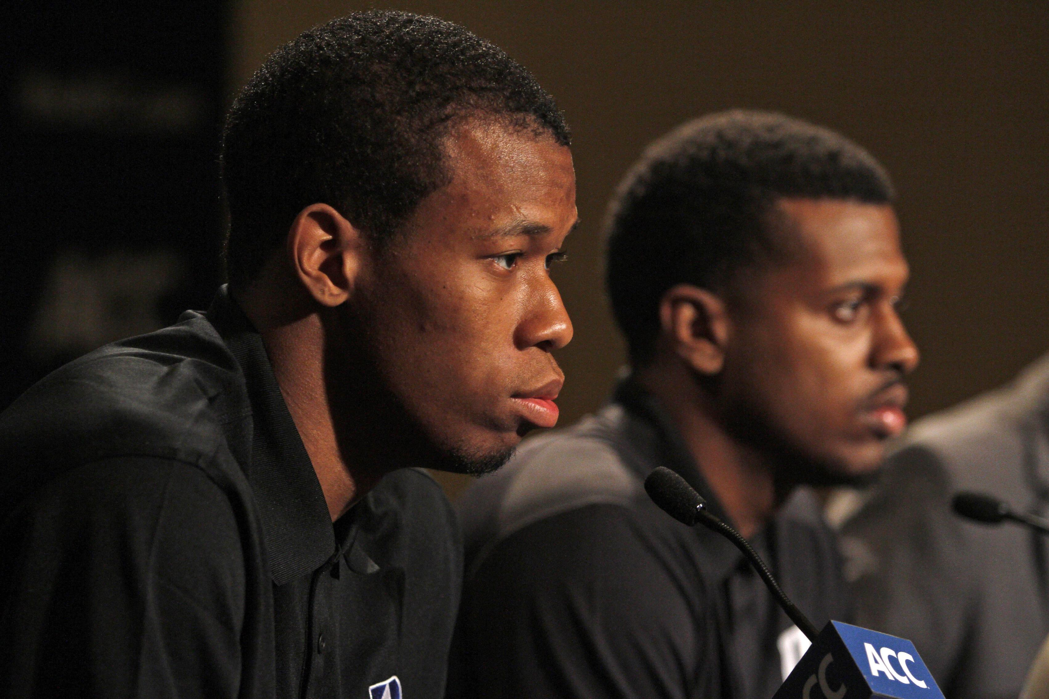 Duke basketball players Rodney Hood, left, and Tyler Thornton listen to questions at a press conference during the NCAA college Atlantic Coast Conference media day in Charlotte, N.C., Wednesday, Oct. 16, 2013