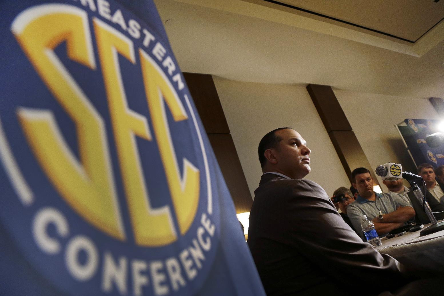 Auburn coach Tony Barbee talks to reporters during the Southeastern Conference NCAA college basketball media day in Birmingham, Ala., Wednesday, Oct. 16, 2013