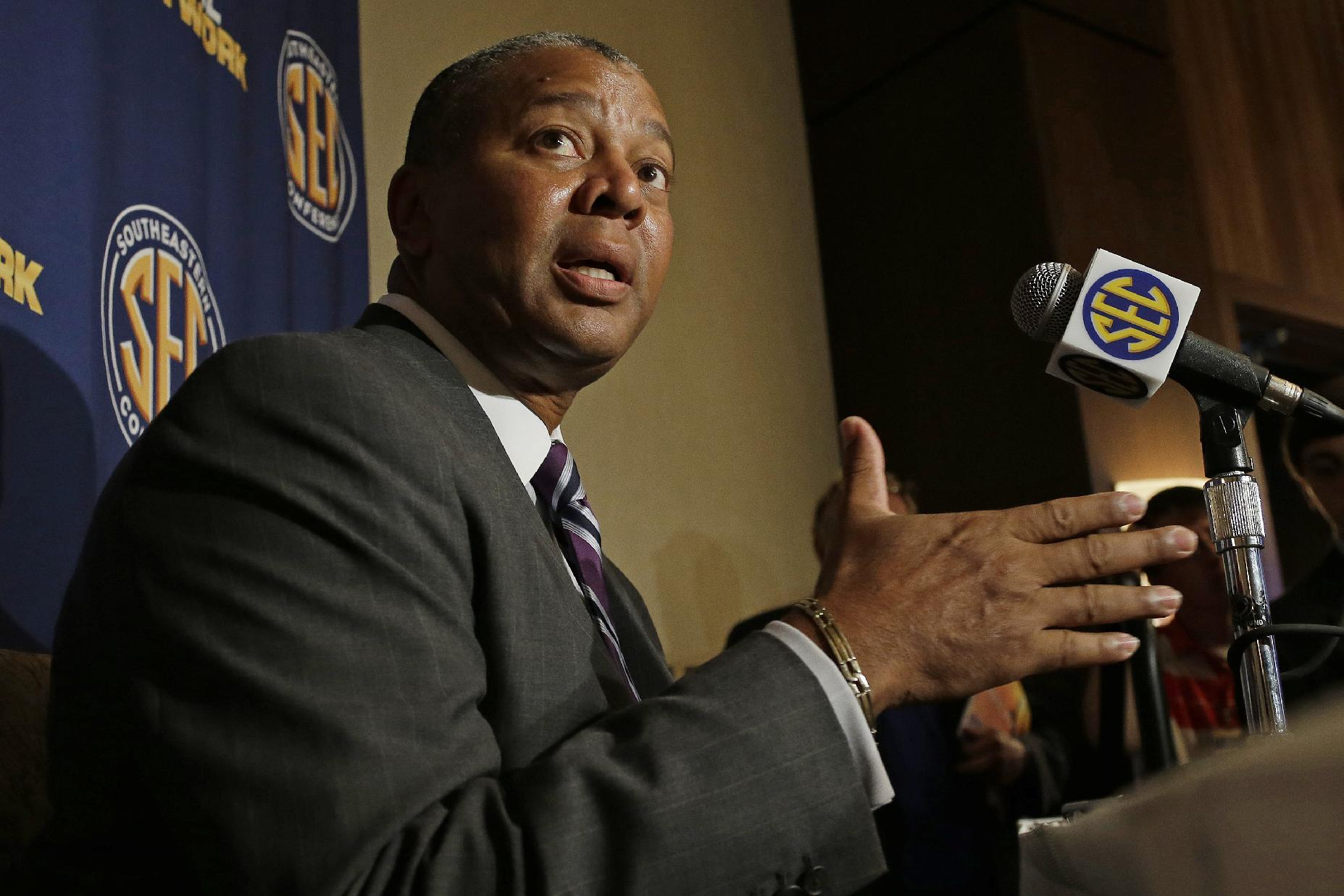 LSU coach Johnny Jones talks with reporters at the Southeastern Conference NCAA college basketball media day in Birmingham, Ala., Wednesday, Oct. 16, 2013