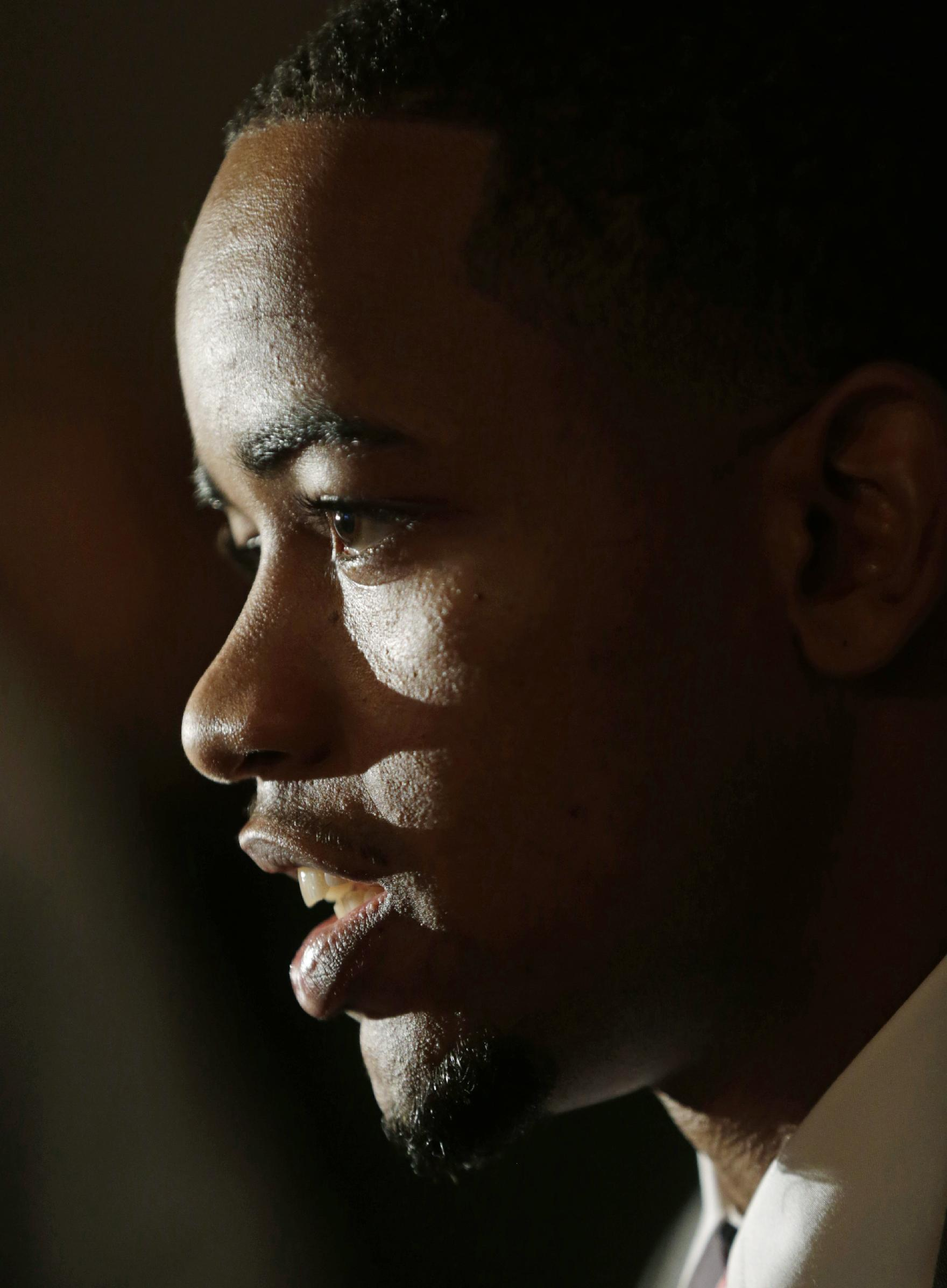 Alabama player Trevor Releford talks with reporters during Southeastern Conference NCAA college basketball media day in Birmingham, Ala., Thursday, Oct. 17, 2013
