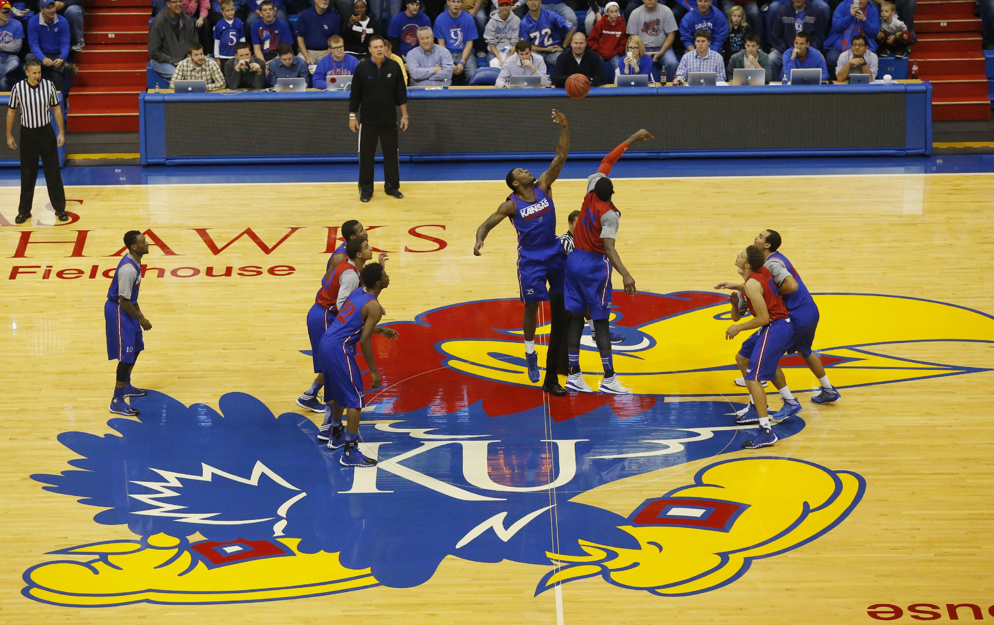 Kansas White and Blue teams tipoff for an NCAA college basketball scrimmage in Lawrence, Kan., Saturday, Oct. 19, 2013