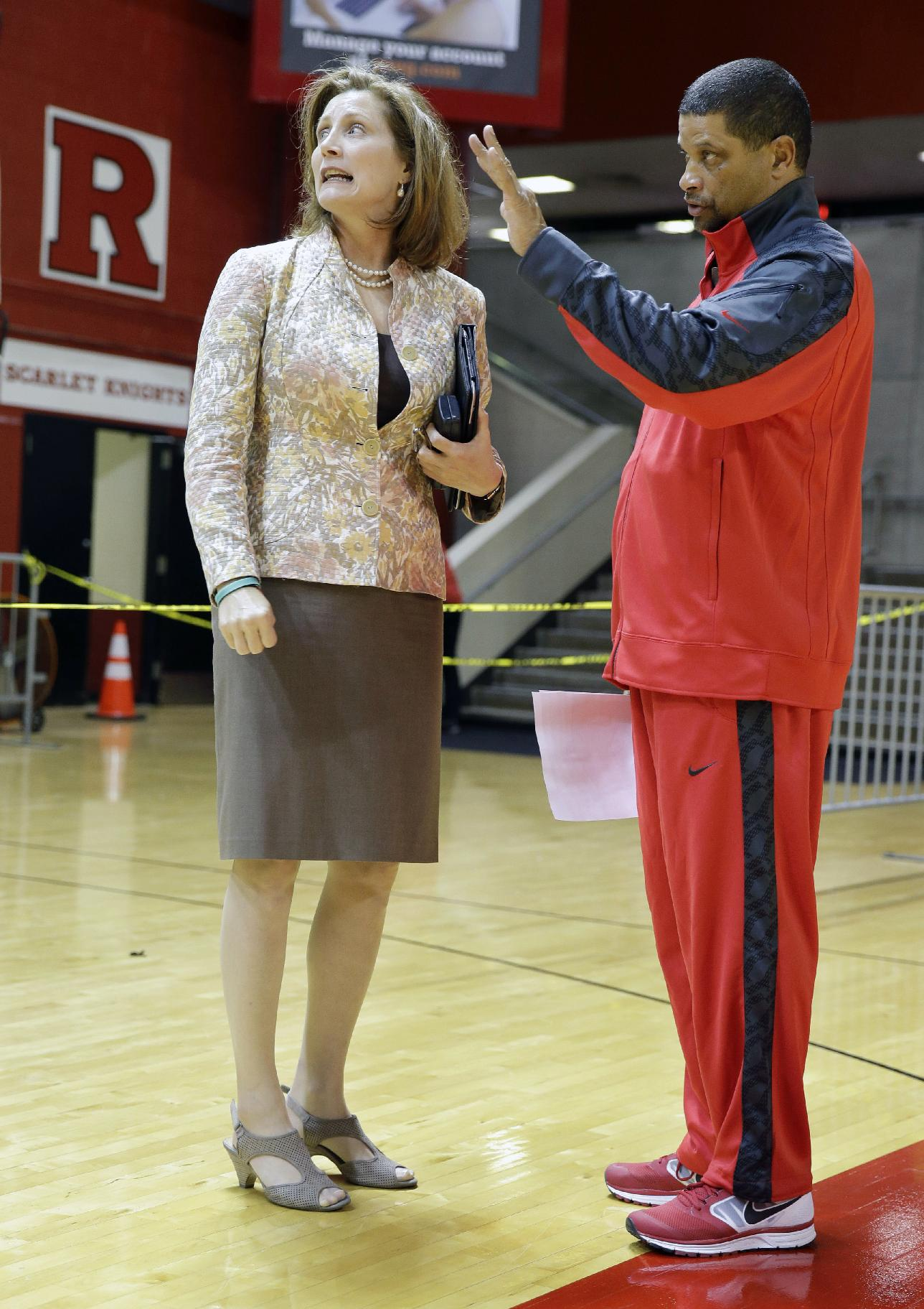 Rutgers University athletic director Julie Hermann, left listens as men's basketball head coach Eddie Jordan talks about renovations at the Rutgers Athletic Center in Piscataway, N.J., Tuesday, Oct. 22, 2013. Jordan was named head coach in April and Hermann athletic director in May, as the school sought to move forward from a scandal that forced the firing of coach Mike Rice and the resignation of athletic director Tim Pernetti