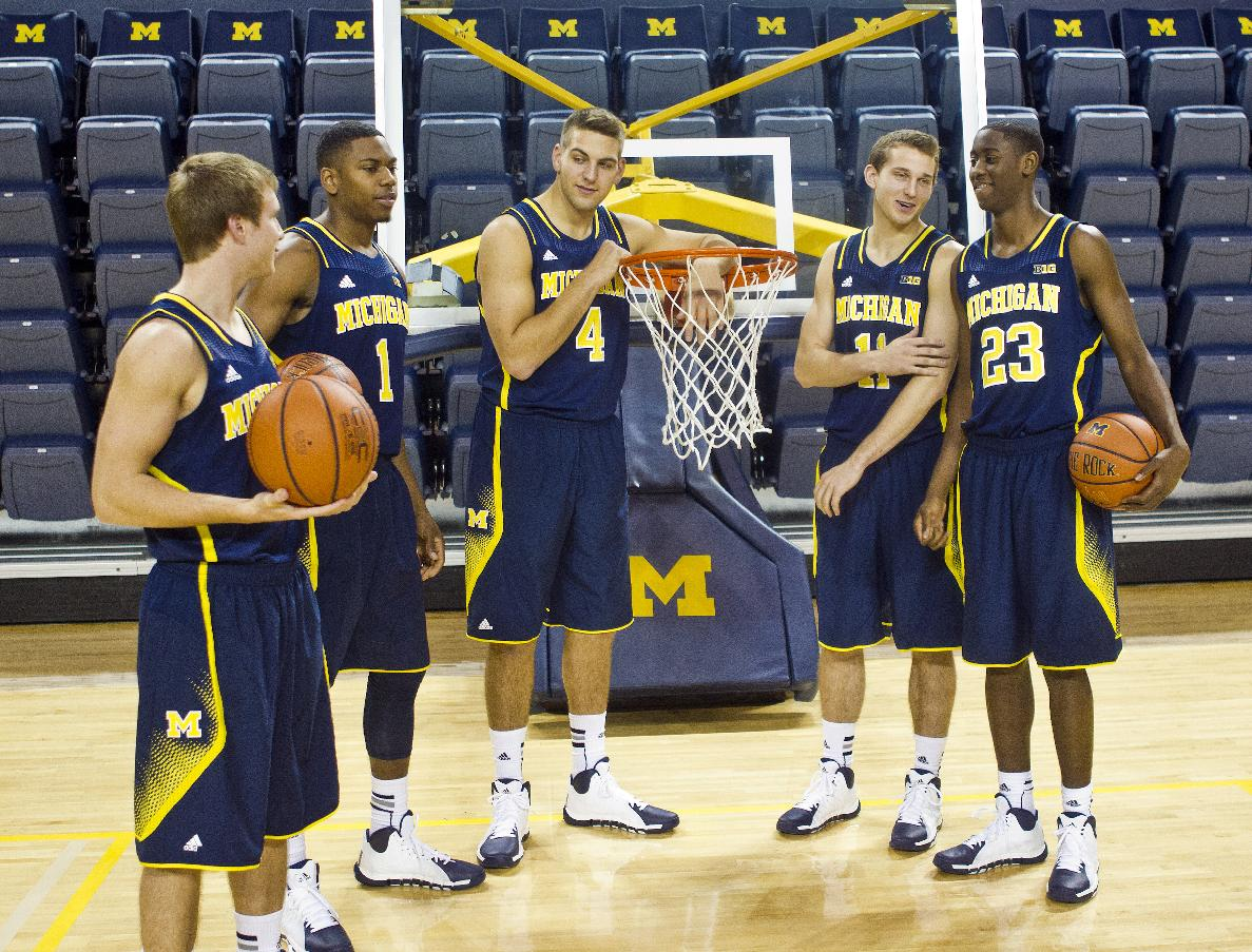 Michigan sophomores, from left to right, guard Spike Albrecht, forward Glenn Robinson III, forward Mitch McGary, guard Nik Stauskas and guard Caris LeVert joke around before posing for portraits during NCAA college basketball media day on Thursday, Oct. 24, 2013, in Ann Arbor, Mich