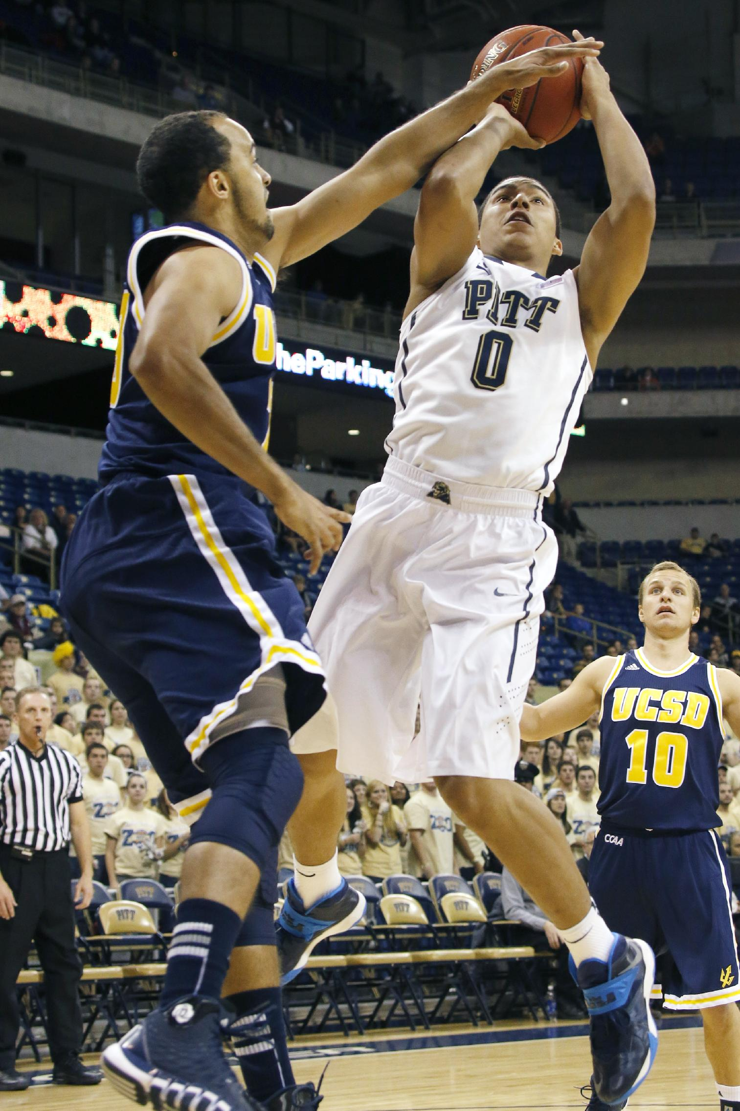 Pittsburgh's James Robinson (0) shoots over UC San Diego's Hunter Walker in the first half of an exhibition NCAA college basketball game on Friday, Oct. 25, 2013, in Pittsburgh