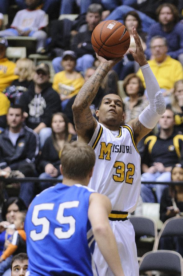 Missouri's Jabari Brown, 32, shoots a 3-pointer in the first half against Oklahoma City in the Hearnes Center on Friday, Oct. 25, 2013