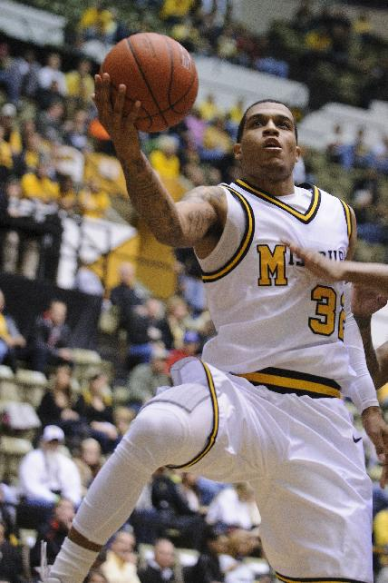 Missouri's Jabari Brown, 32, goes up for a shot in the second half against Oklahoma City in the Hearnes Center on Friday, Oct. 25, 2013