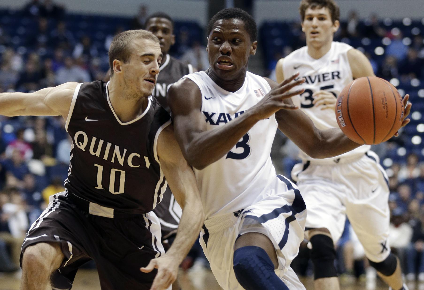 Xavier guard Brandon Randolph (3) drives against Quincy guard Grant Meyer (10) in the first half of an NCAA exhibition college basketball game, Saturday, Nov. 2, 2013, in Cincinnati