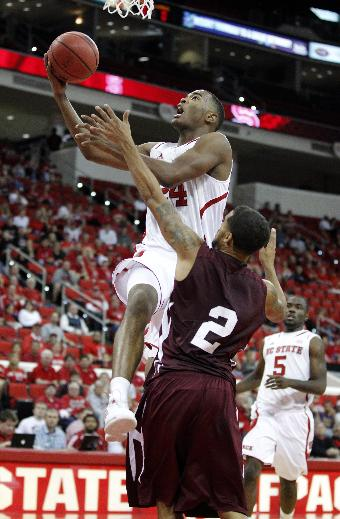 North Carolina State's T.J. Warren (24) drives to the basket as Morehouse's David Buchannon (2) defends during the second half of an NCAA college basketball exhibition game, Saturday, Nov. 2, 2013, at PNC Arena in Raleigh, N.C. N.C. State won 87-62