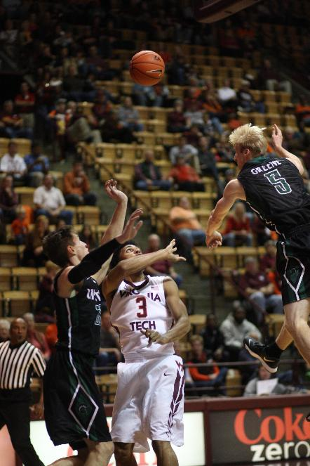 South Carolina Upstate guard Ty Greene (5), right, swats a shot away from Virginia Tech guard Adam Smith center during the first half of an NCAA college basketball game in Blacksburg, Va., Saturday, Nov. 9, 2013