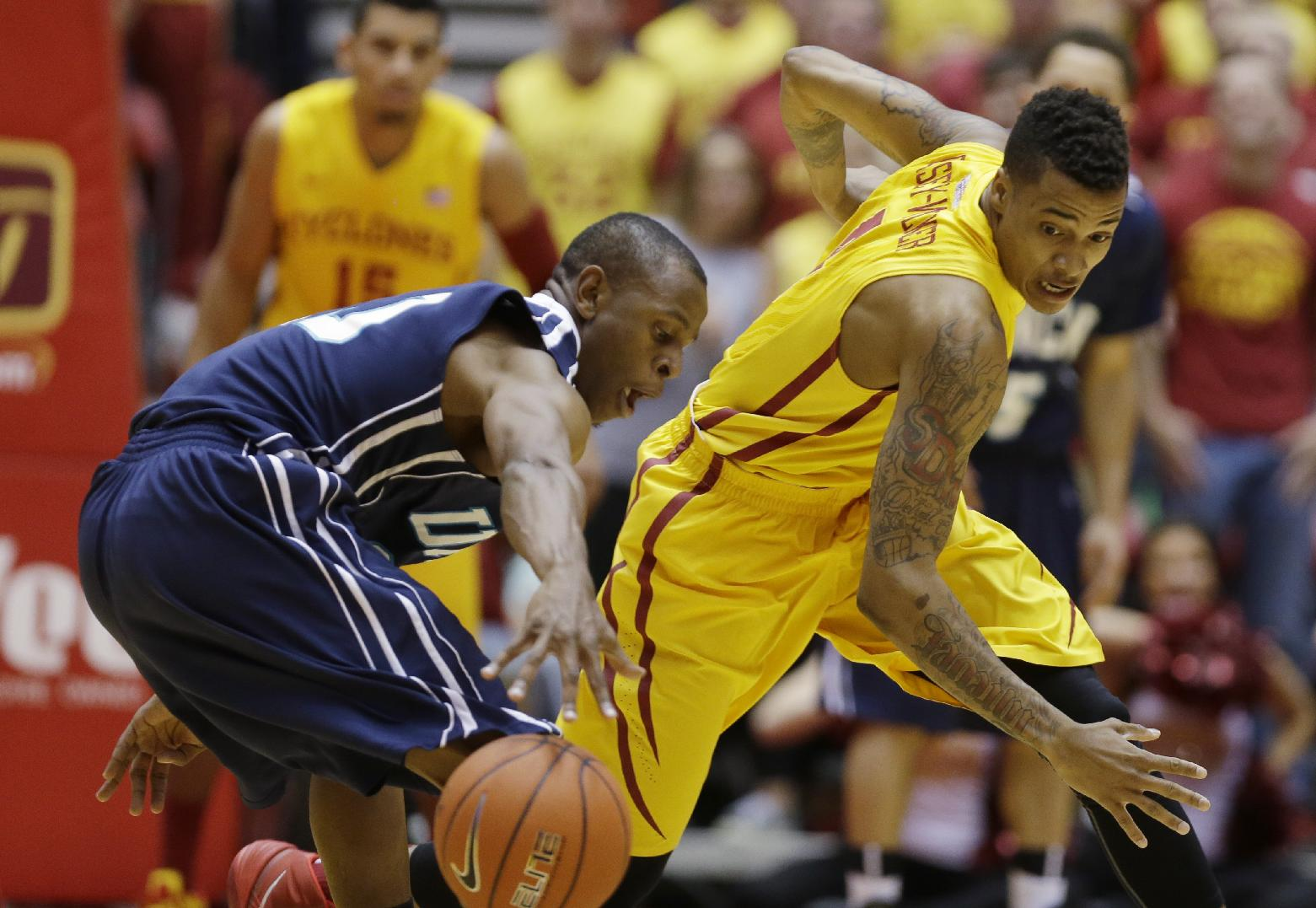 Iowa State guard Sherron Dorsey-Walker, right, tries to steal the ball from UNC Wilmington guard Freddie Jackson during the first half of an NCAA college basketball game on Sunday, Nov. 10, 2013, in Ames, Iowa