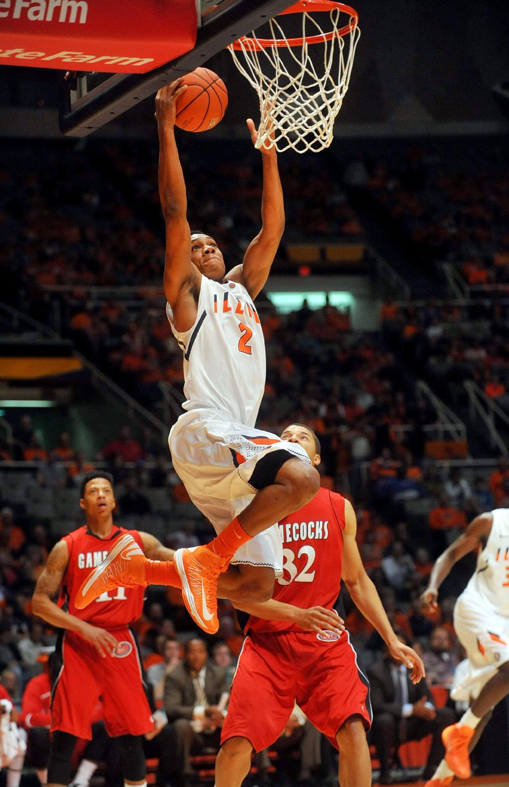 Illinois guard Joseph Bertrand (2) drives past Jacksonville State's Jamal Hunter (32) during the first half of an NCAA college basketball game Sunday, Nov. 10, 2013, in Champaign, Ill