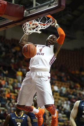 Virginia Tech forward Cadarian Raines (4) dunks during the first half of an NCAA college basketball game against West Virginia in Blacksburg, Va., Tuesday, Nov. 12, 2013