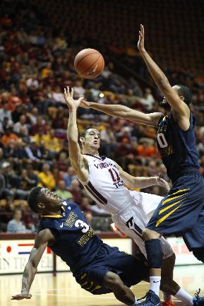 West Virginia forward Remi Dibo, right, knocks the ball away from Virginia Tech guard Devin Wilson (11), center, as West Virginia's Juwan Staten, bottom, looks up at the action during the first half of an NCAA college basketball game in Blacksburg, Va., Tuesday, Nov. 12, 2013