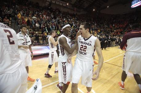 Virginia Tech guard Ben Emelogu (15) and Virginia Tech forward Christian Beyer (22) celebrate after defeating West Virginia 87-82 in an NCAA college basketball game in Blacksburg, Va., Tuesday, Nov. 12, 2013