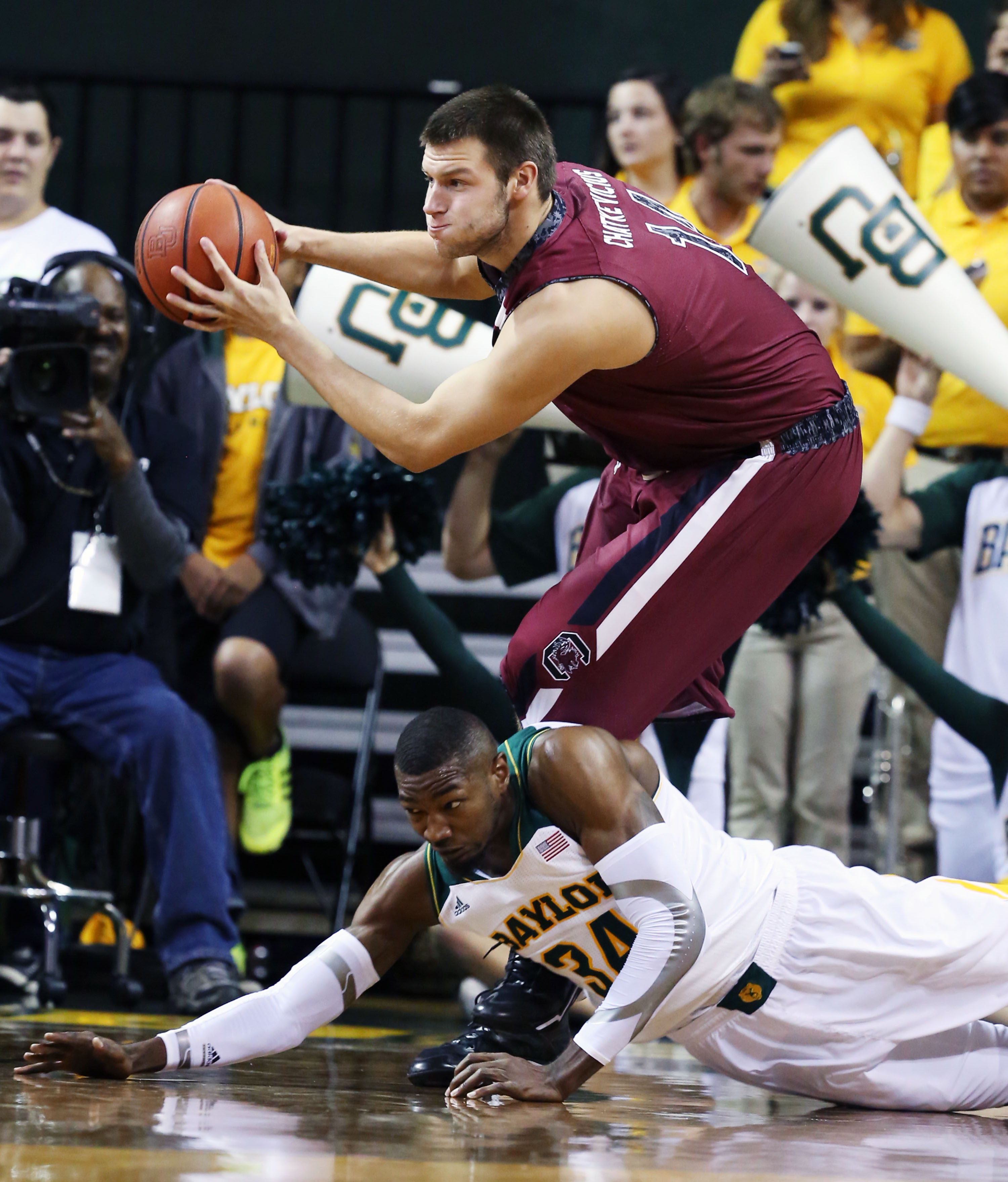 South Carolina Laimonas Chatkevicius (14) pulls down a rebound over Baylor's Cory Jefferson (34) in the first half of an NCAA college basketball game, Tuesday, Nov. 12, 2013, in Waco, Texas