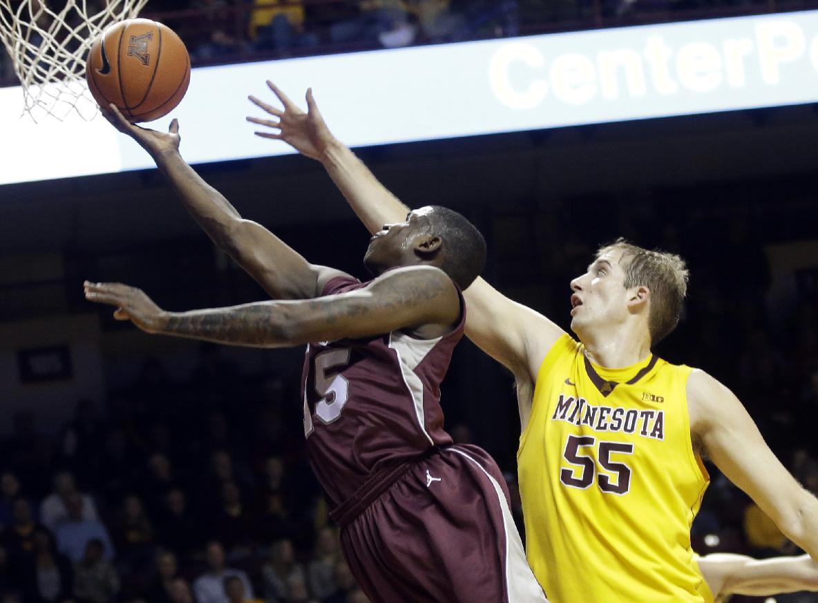 Minnesota's Elliott Eliason (55) defends against Montana's Keron DeShields during the first half of an NCAA college basketball game, Tuesday, Nov. 12, 2013, in Minneapolis