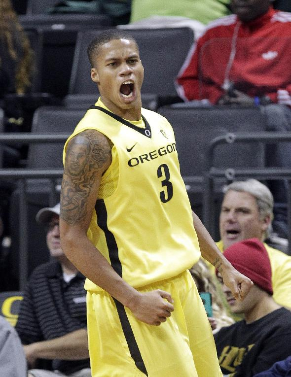 Oregon guard Joseph Young reacts after scoring during the second half of an NCAA college basketball game against Western Carolina in Eugene, Ore., Wednesday, Nov. 13, 2013. Young led Oregon in scoring with 36 points as they won 107-83