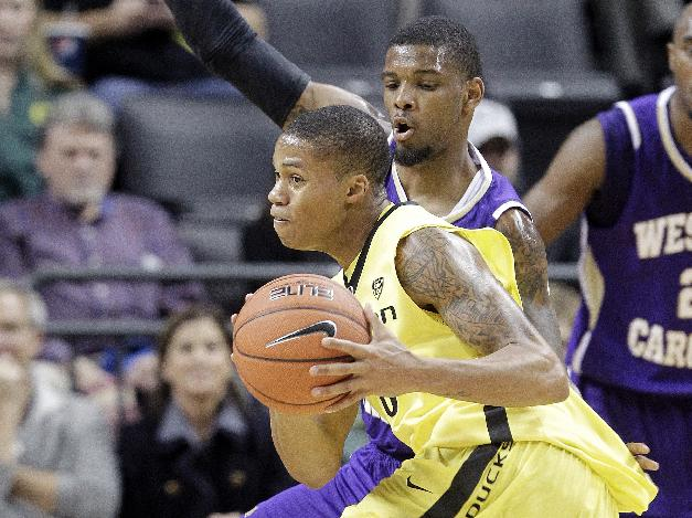 Oregon guard Joseph Young, left, drives past Western Carolina guard Trey Sumler  during the second half of an NCAA college basketball game against Western Carolina in Eugene, Ore., Wednesday, Nov. 13, 2013. Young led Oregon in scoring with 36 points as they won 107-83