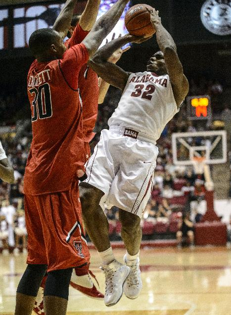 Alabama Guard Retin Obasohan (32) shoots a jumper during an NCAA college basketball game against Texas Tech, Thursday, Nov. 14, 2013, in Tuscaloosa, Ala
