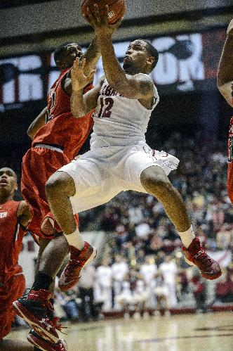 Alabama Guard Trevor Releford (12) gets inside for a score during an NCAA college basketball game against Texas Tech, Thursday, Nov. 14, 2013, in Tuscaloosa, Ala