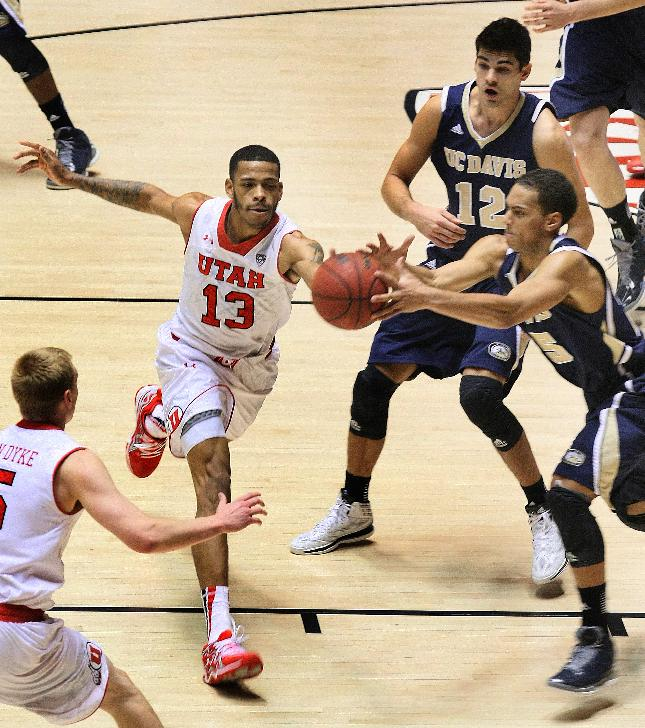 Utah Utes guard Ahmad Fields (13) battles for a loose ball against UC Davis Aggies guard Ryan Sypkens (25) late in the second half. Utah defeated UC Davis 94-60, Friday, Nov. 15, 2013 in Salt Lake City, Utah