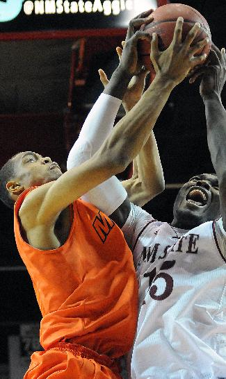 New Mexico State University's Tshilidzi Naphawe and UTEP's Vince Hunter fight for the ball in the while in the air on Friday Nov. 15, 2013 in Las Cruces New Mexico. (AP PHOTO/Robin Zielinski, Las Cruces Sun-News)