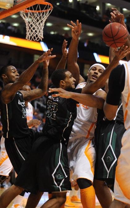 Tennessee's Jarnell Stokes, center, reaches for a rebound with South Carolina-Upstate's Fred Miller during the first half of an NCAA college basketball game at Thompson-Boling Arena in Knoxville, Saturday, Nov. 16, 2013