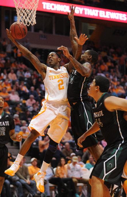 Tennessee's Antonio Barton gets a layup under pressure from  South Carolina-Upstate defenders during the first half of an NCAA college basketball game at Thompson-Boling Arena in Knoxville, Tenn., Saturday, Nov. 16, 2013
