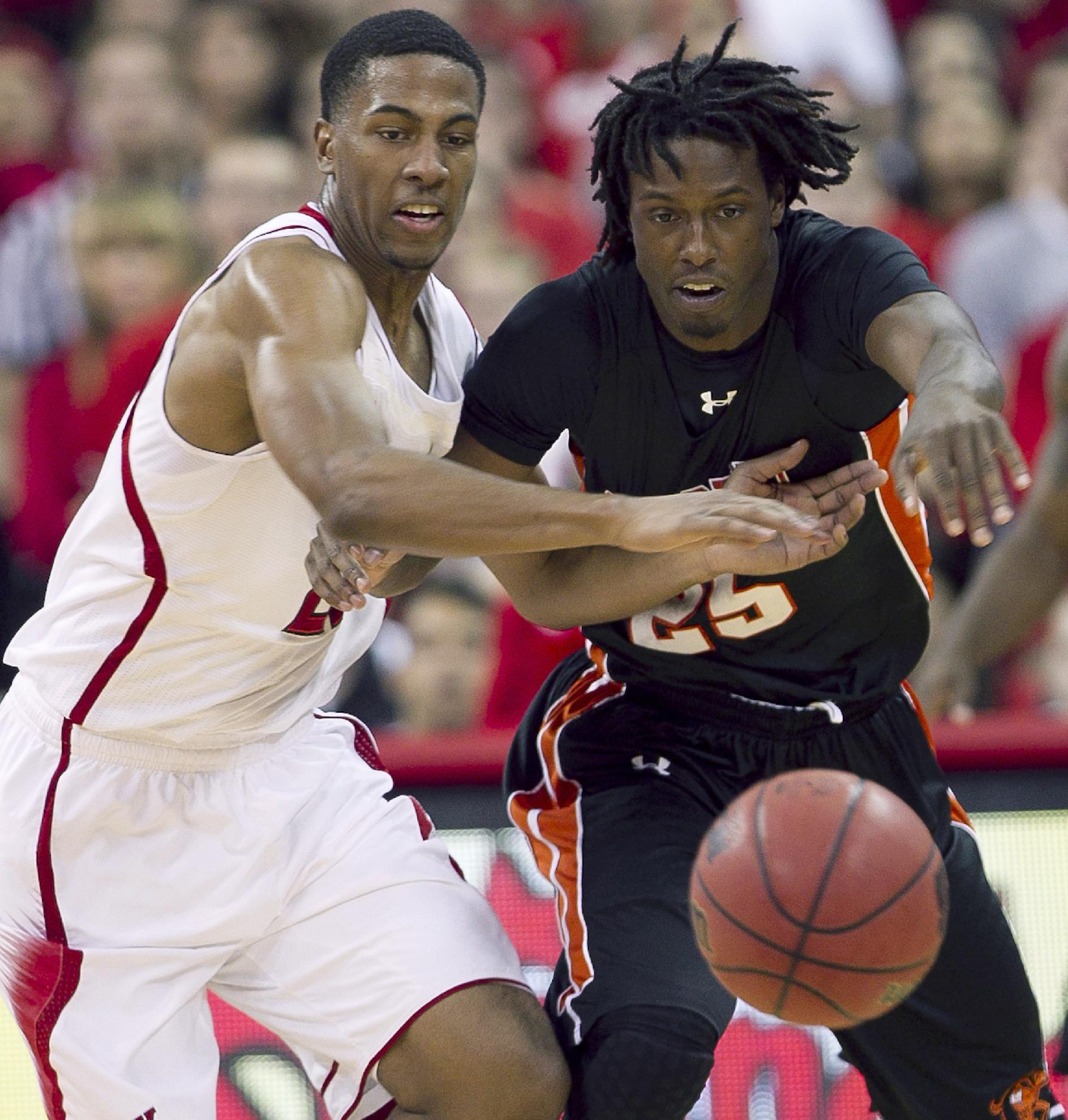 North Carolina State's Ralston Turner (22) makes a steal from Campbell's Reco McCarter (25) during the second half of an NCAA college basketball game Saturday Nov. 16, 2013 in Raleigh, N.C