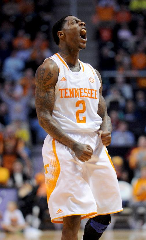 Tennessee's Antonio Barton reacts after hitting a basket to help Tennessee gain the lead over South Carolina-Upstate during the second half of an NCAA college basketball game in Knoxville, Tenn., Saturday, Nov. 16, 2013. Tennessee won 74-65
