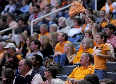 Nine-year-old Tennessee fan Tyler Chrisman cheers as the Volunteers mount a comeback against South Carolina-Upstate during the second half of an NCAA college basketball game in Knoxville, Tenn., Saturday, Nov. 16, 2013. Tennessee won 74-65