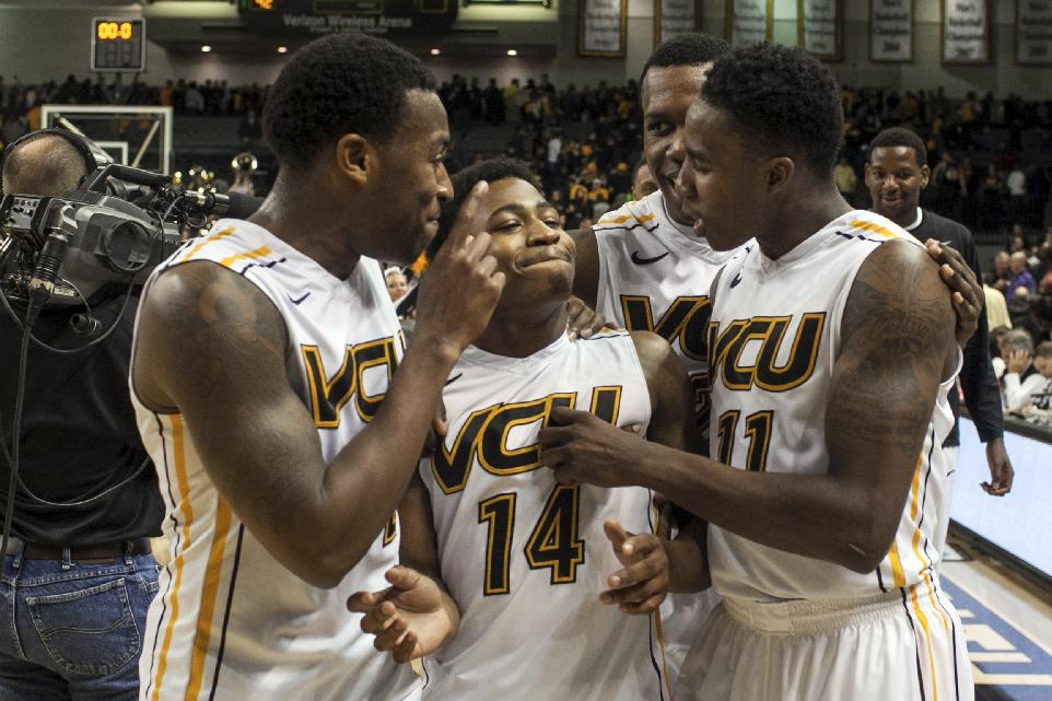 VCU's, from left, Melvin Johnson, Treveon Graham, and Rob Brandenberg celebrate after the team's win over Winthrop in Richmond, Va., Saturday, Nov. 16, 2013. VCU won 92-71