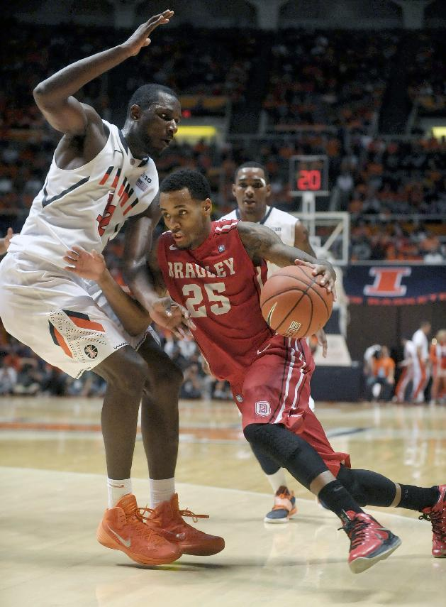 Bradley Braves guard Walt Lemon, Jr. (25) drives on Illinois forward/center Nnanna Egwu in the second half of an NCAA college basketball game Sunday, Nov. 17, 2013, in Champaign, Ill