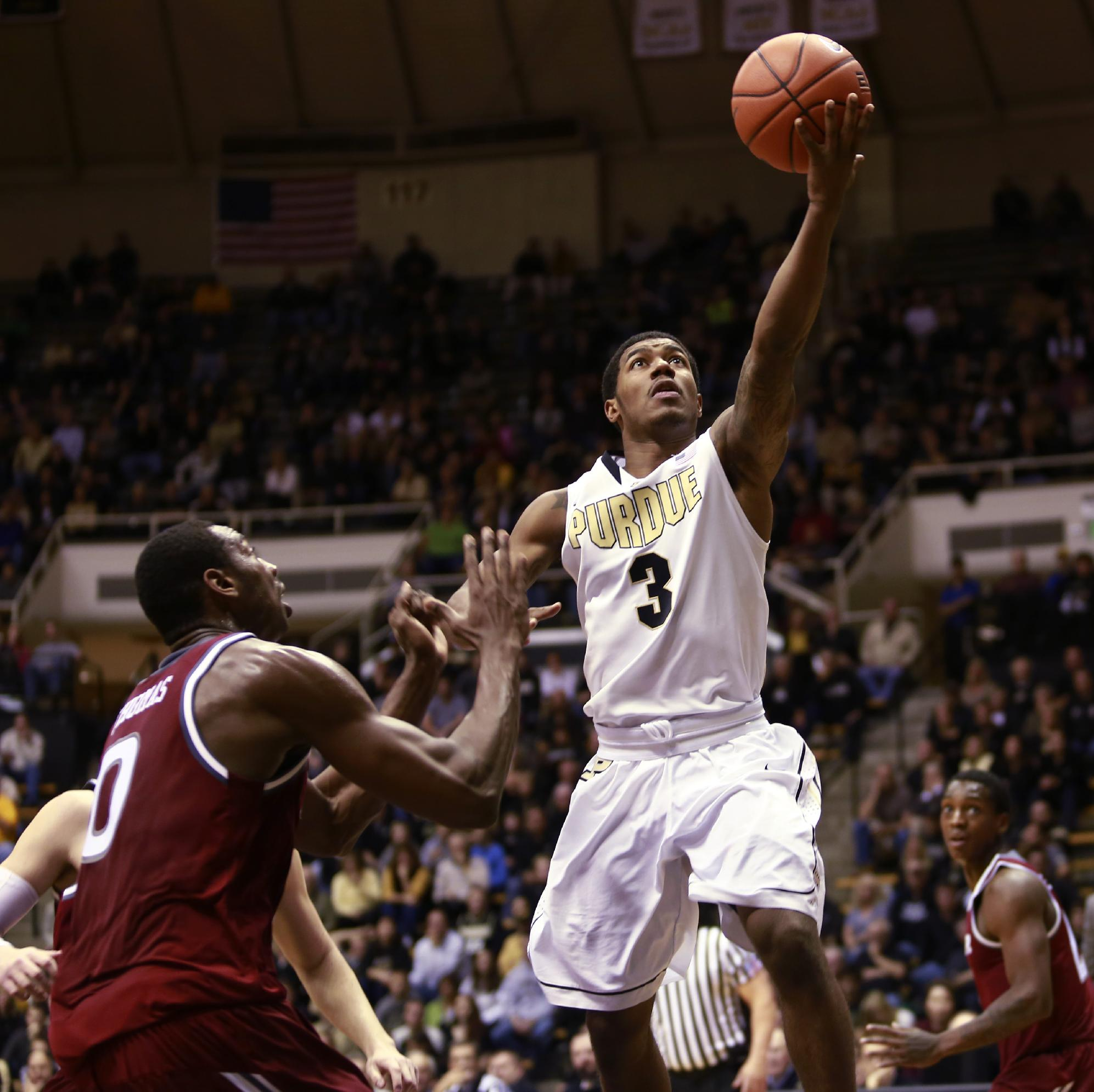 Purdue guard Ronnie Johnson (3) puts up a shot near Rider forward Emerson Bursis (L) in the second half of an NCAA basketball game versus Purdue in West Lafayette, Ind., Sunday, Nov. 17, 2013. Purdue won 81-77