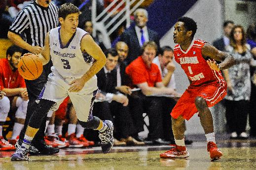 Northwestern's Dave Sobolewski, left, dribbles near Illinois State's Paris Lee during the first half of an NCAA college basketball game in Evanston, Ill., on Saturday, Nov. 17, 2013