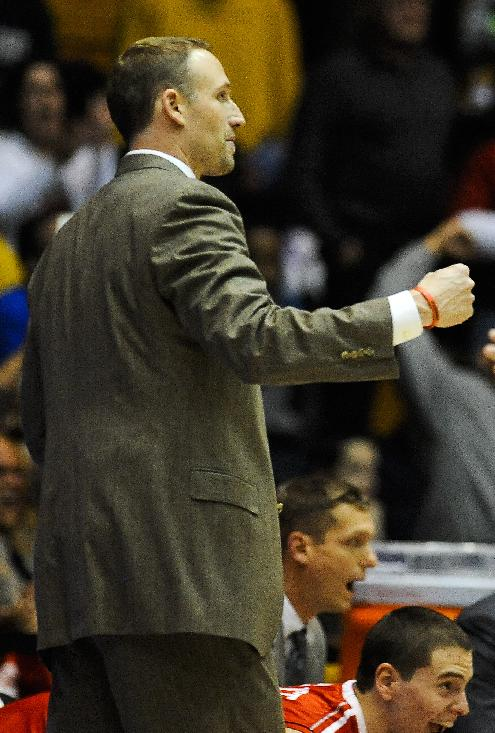 Illinois State head coach Dan Muller pumps his fist as his team beat Northwestern 68-64 at the end of an NCAA college basketball game in Evanston, Ill., on Sunday, Nov. 17, 2013