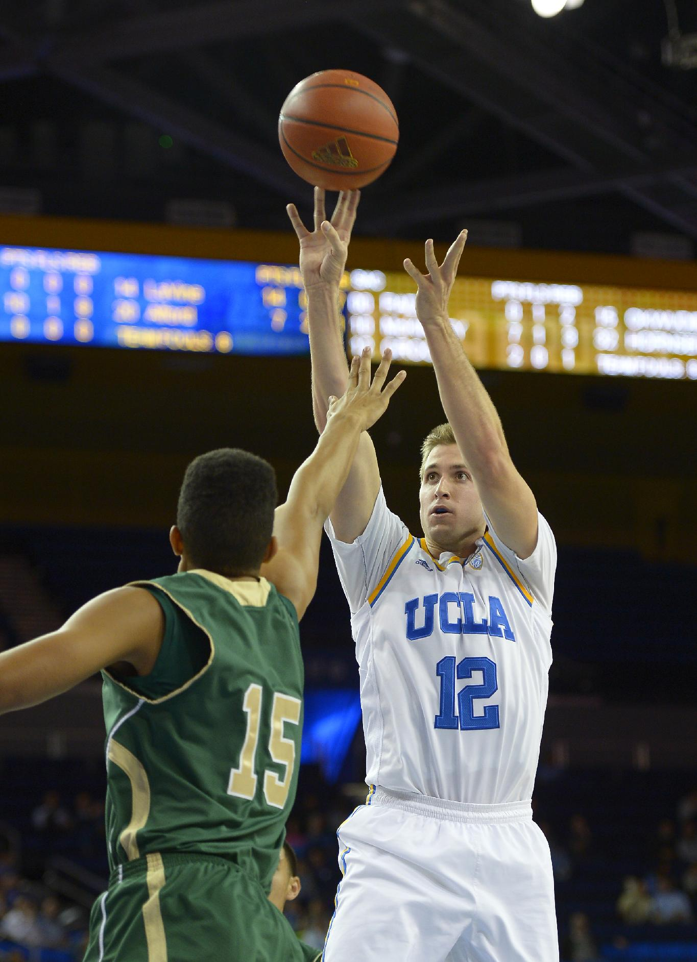 UCLA forward David Wear, right, puts up a shot as Sacramento center Ryan Okwudibonye defends during the second half of an NCAA college basketball game, Monday, Nov. 18, 2013, in Los Angeles