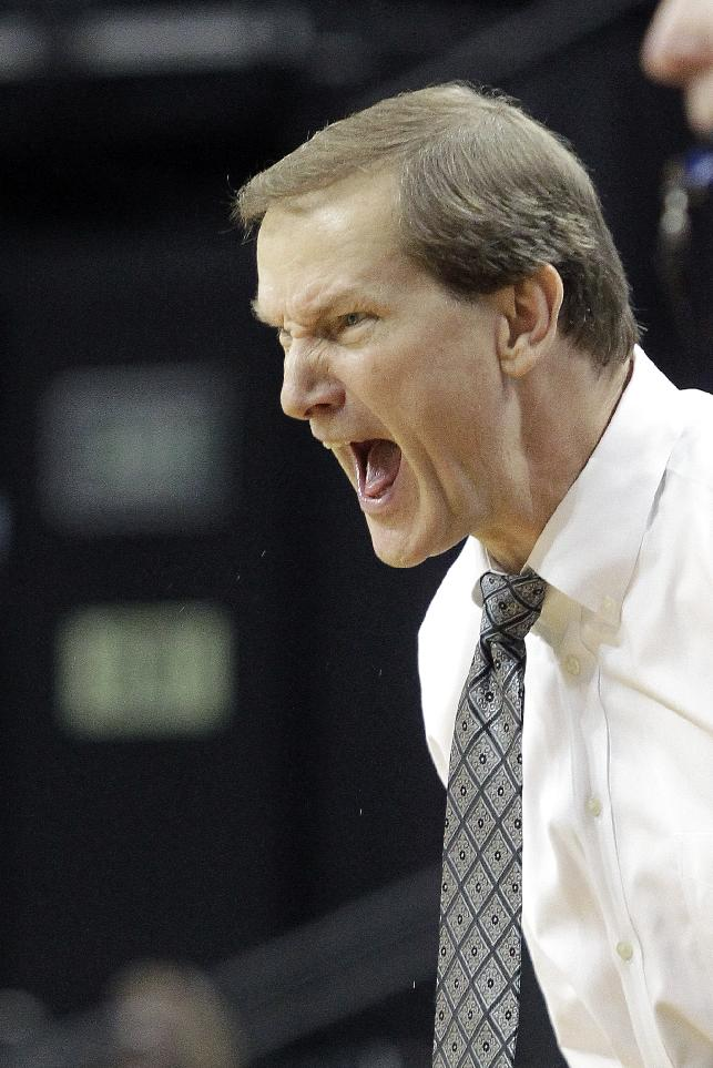 Oregon coach Dana Altman yells from the bench during the second half of an NCAA college basketball game against Utah Valley in Eugene, Ore., Tuesday, Nov. 19, 2013.  Oregon won 69- 54