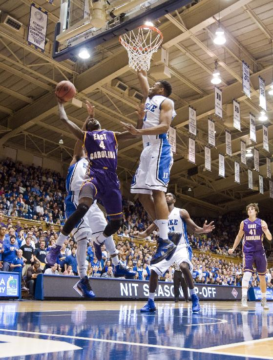 ECU's Prince Williams takes a layup defended by Duke's Jabari Parker and Quinn Cook Tuesday night at Cameron Indoor Stadium in Durham, N.C