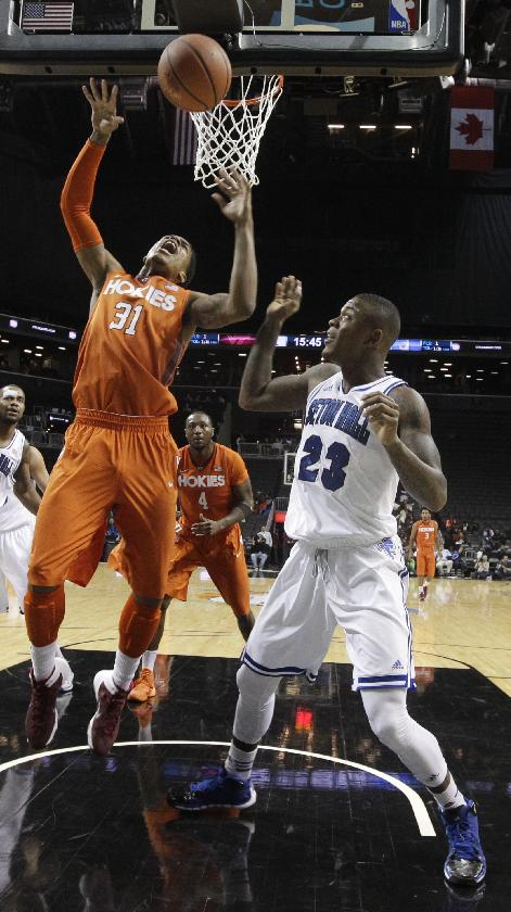 Seton Hall's Fuquan Edwin (23) defends against Virginia Tech's Jarell Eddie (31) during the first half of a consolation game in the Coaches vs. Cancer NCAA college basketball game on Saturday, Nov. 23, 2013, in New York
