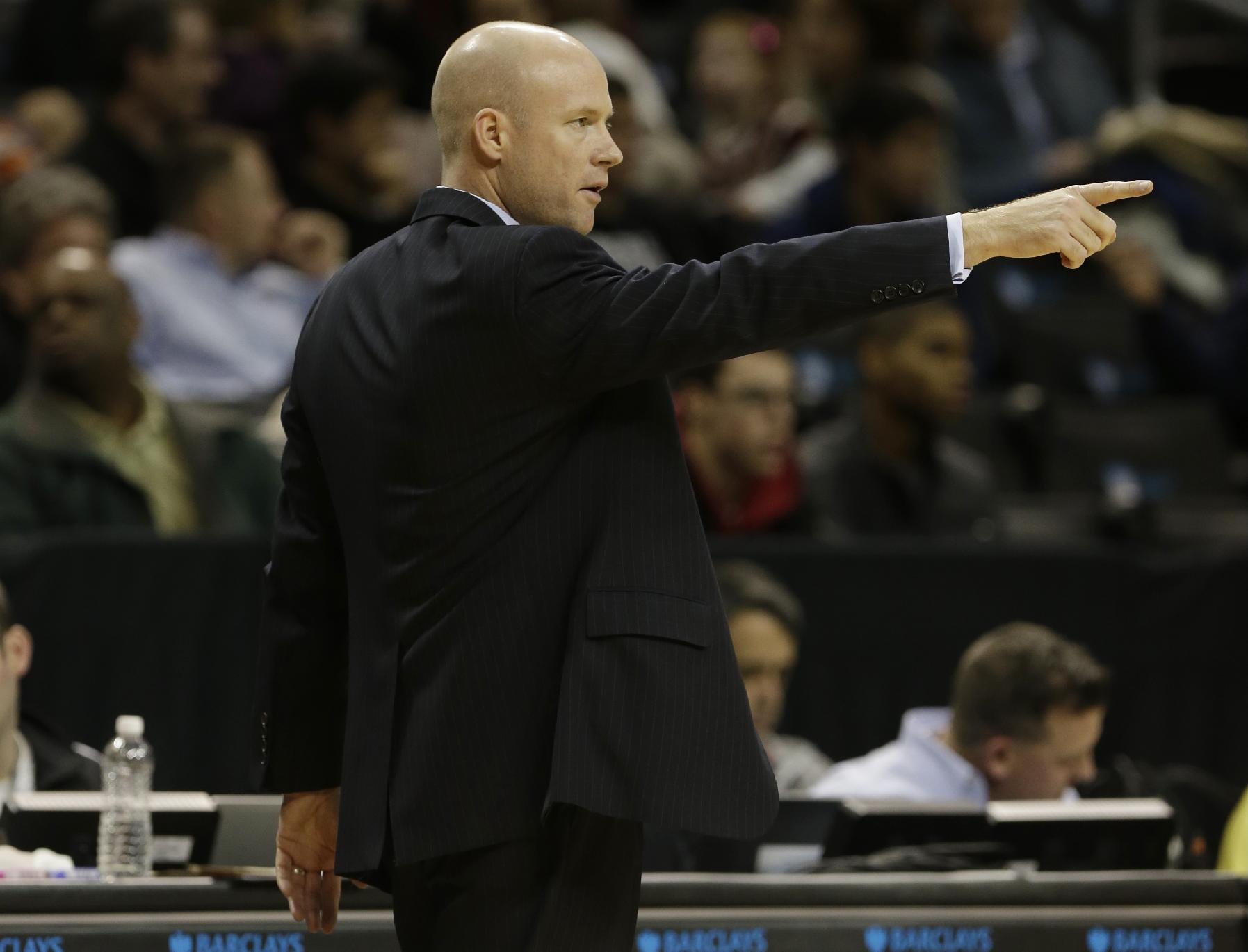 Seton Hall head coach Kevin Willard points to his team during the first half of a consolation game against the Virginia Tech in the Coaches vs. Cancer NCAA college basketball game on Saturday, Nov. 23, 2013, in New York
